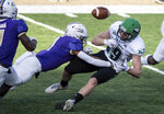 James Madison safety Que Reid, left, forces a fumble by North Dakota tight end Adam Zavalney, right, during the first half of a quarterfinal game in the NCAA FCS football playoffs in Harrisonburg, Va., Sunday, May 2, 2021. (Daniel Lin/Daily News-Record via AP)