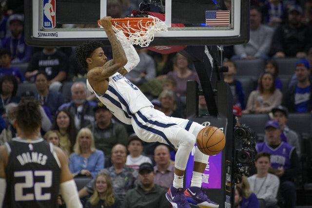 Memphis Grizzlies guard Ja Morant (12) dunks against the Sacramento Kings during the first quarter of an NBA basketball game in Sacramento, Calif., Thursday, Jan. 2, 2020. (AP Photo/Randall Benton)