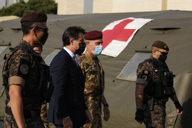 Italian Prime Minister Giuseppe Conte, second left, visits an Italian field hospital set up at the Lebanese University in the Hadath district of Beirut, Lebanon, Tuesday, Sept. 8, 2020. Conte said Tuesday his country will support Lebanon's economic and social growth, expressing hopes that a new government is formed quickly — one that would start the reconstruction process in the wake of last month's Beirut explosion and implement badly needed reforms. (AP Photo/Hassan Ammar)