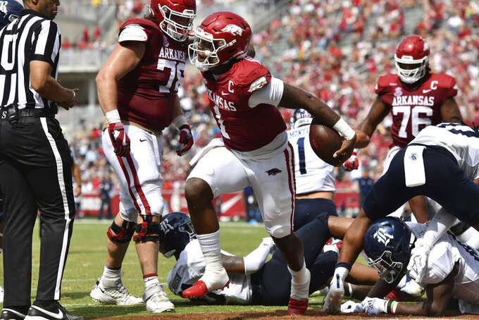 Arkansas quarterback KJ Jefferson (1) celebrates after running for a touchdown against Rice during the second half of an NCAA college football game Saturday, Sept. 4, 2021, in Fayetteville, Ark. (AP Photo/Michael Woods)