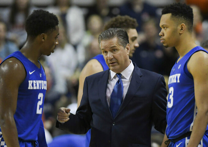 Kentucky head coach John Calipari talks with players during a timeout during the first half of an NCAA college basketball game against Auburn Saturday, Jan. 19, 2019, in Auburn, Ala. (AP Photo/Julie Bennett)