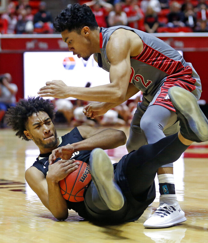 Utah guard Sedrick Barefield (2) battles for the ball with Colorado guard D'Shawn Schwartz, left, during the first half of an NCAA college basketball game Sunday, Jan. 20, 2019, in Salt lake City. (AP Photo/Rick Bowmer)