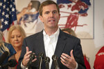 Kentucky democratic gubernatorial candidate and Attorney General Andy Beshear speaks to the media during a press conference at the Muhammad Ali Center, Wednesday, Nov. 6, 2019, in Louisville, Ky. (AP Photo/Bryan Woolston)