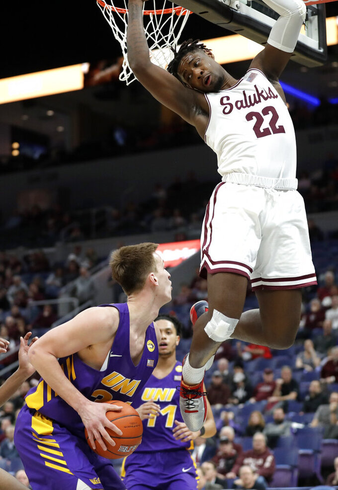 Northern Iowa's Luke McDonnell looks to the basket as Southern Illinois' Armon Fletcher (22) defends during the second half of an NCAA college basketball game in the quarterfinals of the Missouri Valley Conference men's tournament Friday, March 8, 2019, in St. Louis. Northern Iowa won 61-58. (AP Photo/Jeff Roberson)