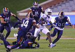North Carolina running back Michael Carter (8) runs between a gaggle of Virginia defenders during an NCAA college football game Saturday, Oct. 31, 2020, in Charlottesville, Va. (Andrew Shurtleff/The Daily Progress via AP)