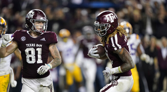 Texas A&M wide receiver Kendrick Rogers, right, catches a pass for a two-point conversion during the seventh overtime of an NCAA college football game against LSU Saturday, Nov. 24, 2018, in College Station, Texas. Texas A&M won 74-72. (AP Photo/David J. Phillip)