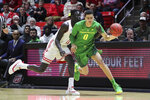 Oregon guard Will Richardson (0) is fouled by Utah forward Both Gach (11) while bringing the ball up during the first half of an NCAA college basketball game Thursday, Jan. 31, 2019, in Salt Lake City. (AP Photo/Chris Nicoll)