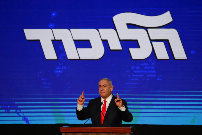 Israeli Prime Minister Benjamin Netanyahu delivers a speech following the announcement of the first exit poll results for the Israeli parliamentary elections, at his Likud party headquarters in Jerusalem, Wednesday, March. 24, 2021. (AP Photo/Maya Alleruzzo)