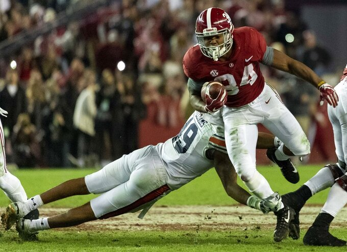 Alabama running back Damien Harris (34) gets past Auburn linebacker Darrell Williams (49) during the second half of an NCAA college football game, Saturday, Nov. 24, 2018, in Tuscaloosa, Ala. (AP Photo/Vasha Hunt)