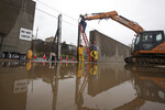 Workers with the City of Vicksburg start construction on one of the three flood wall gates on Levee Street in Vicksburg Miss., on Thursday Feb. 21, 2019. According to the National Weather Service the Mississippi River is currently at 44.69 feet and is expected to reach 48.9 feet. (Courtland Wells/The Vicksburg Post, via AP)