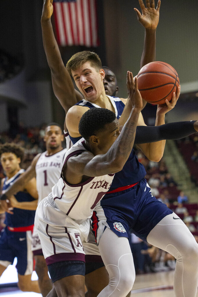 Gonzaga forward Filip Petrusev (3) is fouled by Texas A&M guard Jay Jay Chandler (0) during the first half of an NCAA college basketball game Friday, Nov. 15, 2019, in College Station, Texas. (AP Photo/Sam Craft)