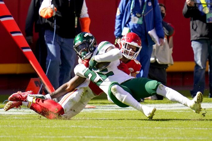New York Jets running back La'Mical Perine (22) is tackled by Kansas City Chiefs safety Daniel Sorensen (49) after a short gain in the first half of an NFL football game on Sunday, Nov. 1, 2020, in Kansas City, Mo. (AP Photo/Jeff Roberson)