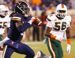 Virginia quarterback Bryce Perkins (3) looks to pass the ball as Miami linebacker Michael Pinckney (56) pursues during the second half of an NCAA college football game in Charlottesville, Va., Saturday, Oct. 13, 2018. Virginia defeated Miami 16-13. (AP Photo/Steve Helber)