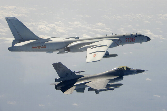 In this photo taken Feb. 10, 2020, and released by the Republic of China (ROC) Ministry of National Defense, a Taiwanese Air Force F-16 in foreground flies on the flank of a Chinese People's Liberation Army Air Force (PLAAF) H-6 bomber as it passes near Taiwan. (Republic of China (ROC) Ministry of National Defense via AP)