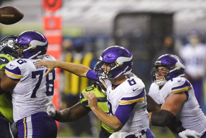 Minnesota Vikings quarterback Kirk Cousins throws against the Seattle Seahawks during the second half of an NFL football game, Sunday, Oct. 11, 2020, in Seattle. (AP Photo/Ted S. Warren)