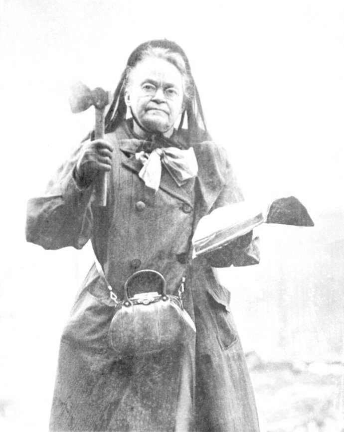 FILE - In this 1910 file photo temperance leader Carrie Nation wields her hatchet and bible in 1910. Nation has destroyed more than a few saloons with her hatchet. Ratification of the 18th Amendment in 1919, which set the stage for Prohibition's launch a year later, culminated a century of advocacy by the temperance movement. Leading forces included the Women's Christian Temperance Union, the Anti-Saloon League and many Protestant denominations. (AP Photo, File)