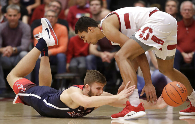 Arizona forward Ryan Luther, left, reaches for the ball under Stanford forward Oscar da Silva during the first half of an NCAA college basketball game in Stanford, Calif., Wednesday, Jan. 9, 2019. (AP Photo/Jeff Chiu)