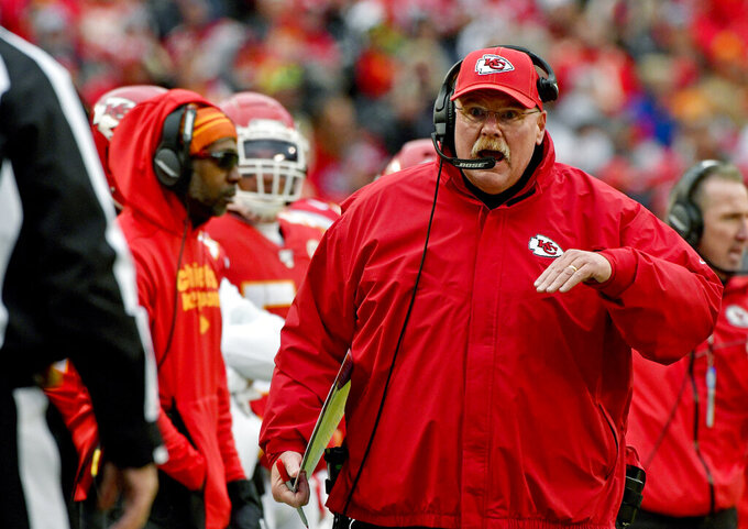 FILE - In this Sunday, Dec. 29, 2019 file photo, Kansas City Chiefs head coach Andy Reid talks to down judge Tom Stephan (68), during the second half of an NFL football game against the Los Angeles Chargers in Kansas City, Mo. Of the coaches in the NFL's Final Four, Andy Reid is the outlier. Only Kansas City's coach has been the head man in a Super Bowl. Only Reid is close to having a Hall of Fame-worthy resume. Only Reid has been around for a couple of decades.  (AP Photo/Ed Zurga. File)