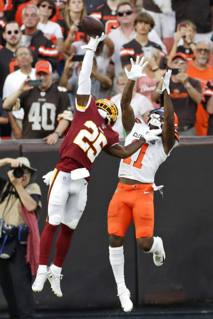 FILE - In this Aug. 8, 2019, file photo, Washington Redskins cornerback Jimmy Moreland (25) breaks up a pass intended for Cleveland Browns wide receiver Antonio Callaway (11) during the first half of an NFL preseason football game in Cleveland. He's one of the smallest players in camp with the Redskins, but cornerback Jimmy Moreland will arrive at the team's practice facility in Ashburn on Tuesday, Aug. 13, having had one of the biggest impacts on the team so far this preseason. (AP Photo/Ron Schwane, File)