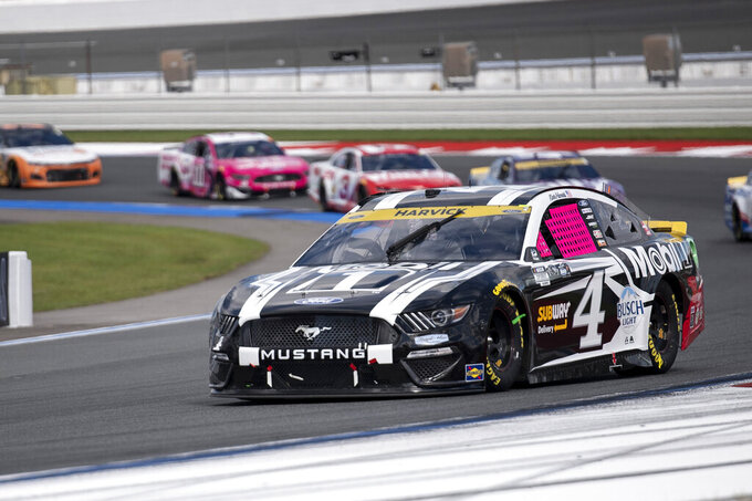 Kevin Harvick (4) competes during a NASCAR Cup Series auto racing race at Charlotte Motor Speedway, Monday, Oct. 11, 2021, in Concord, N.C. (AP Photo/Matt Kelley)