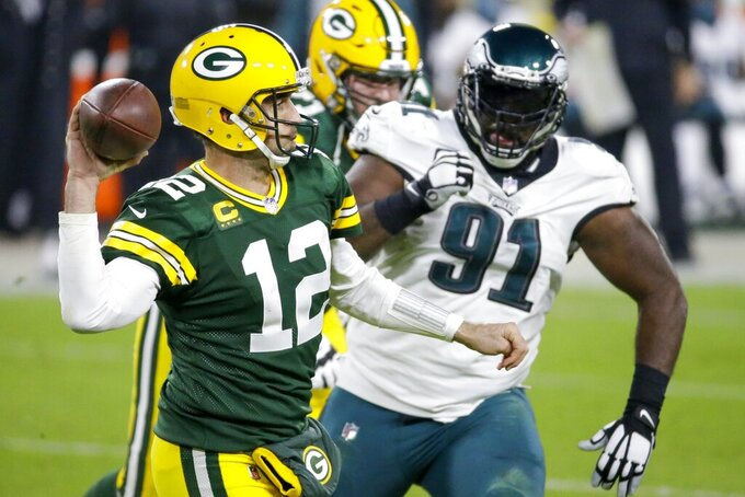 Green Bay Packers' Aaron Rodgers throws during the second half of an NFL football game against the Philadelphia Eagles Sunday, Dec. 6, 2020, in Green Bay, Wis. (AP Photo/Mike Roemer)