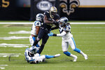 New Orleans Saints running back Latavius Murray (28) is stopped by Carolina Panthers outside linebacker Shaq Thompson (54), outside linebacker Jeremy Chinn (21) and cornerback Troy Pride (25) in the first half of an NFL football game in New Orleans, Sunday, Oct. 25, 2020. (AP Photo/Brett Duke)