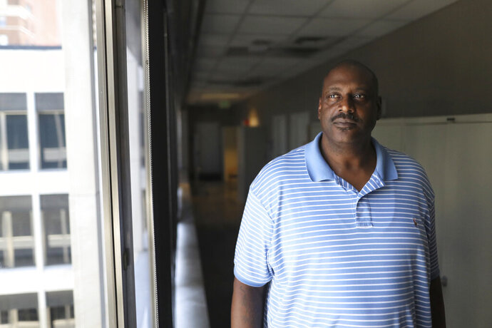 In this Thursday, July 11, 2019, photo, former University of Memphis and NBA basketball player William Bedford poses for a photo inside City Hall, in Memphis, Tenn. After serving a seven-year prison sentence, Bedford returned to Memphis and enrolled in the city's Manhood University, a six-week program aimed to equip men with life skills, which he says has helped him turn his life around. (Joe Rondone/The Commercial Appeal via AP)