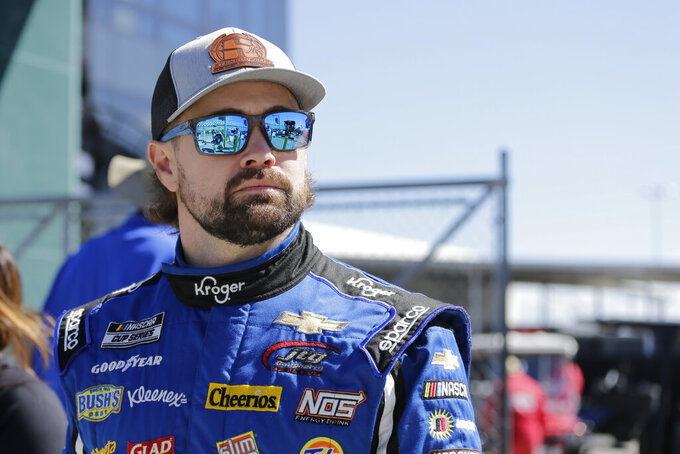 Ricky Stenhouse Jr. walks along pit road before NASCAR auto race qualifying at Daytona International Speedway, Sunday, Feb. 9, 2020, in Daytona Beach, Fla. (AP Photo/Terry Renna)