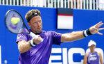 Springfield Laser tennis player Robert Lindstedt returns a serve during the World TeamTennis tournament at The Greenbrier resort Sunday, July 12, 2020, in White Sulphur Springs, W.Va. (AP Photo/Steve Helber)