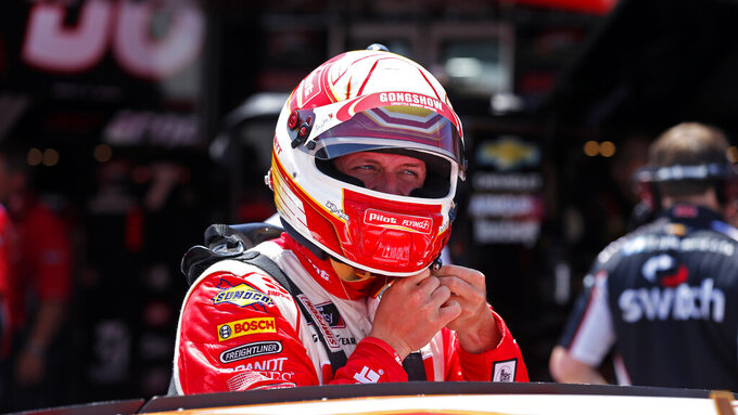 Driver Michael Annett is seen in the pits before practice for an NASCAR Xfinity Series auto race on Thursday, Aug. 15, 2019, in Bristol, Tenn. (AP Photo/Wade Payne)