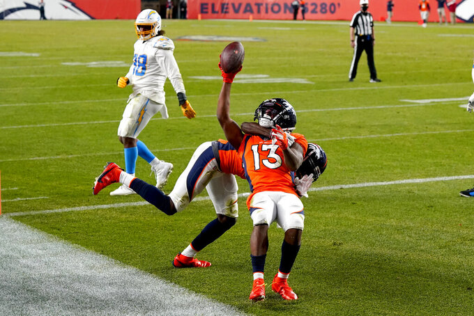 Denver Broncos wide receiver K.J. Hamler (13) celebrates his game-tying touchdown against the Los Angeles Chargers during the second half of an NFL football game, Sunday, Nov. 1, 2020, in Denver. The Broncos won 31-30. (AP Photo/David Zalubowski)