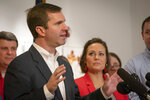 Kentucky Democratic gubernatorial candidate and Attorney General Andy Beshear stands with Lt. Governor candidate Jacqueline Coleman, while speaking to the media during a press conference at the Muhammad Ali Center, Wednesday, Nov. 6, 2019, in Louisville, Ky. (AP Photo/Bryan Woolston)