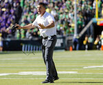 Oregon head coach Mario Cristobol, gives feedback to the officials as they play Washington during an NCAA college football game in Eugene, Ore., Saturday, Oct. 13, 2018. (AP Photo/Thomas Boyd)