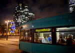 People with face masks sit in a tram in downtown Frankfurt, Germany, Thursday, Nov. 26, 2020. The German parliament discussed the new restrictions to avoid the outspread of the coronavirus today. (AP Photo/Michael Probst)