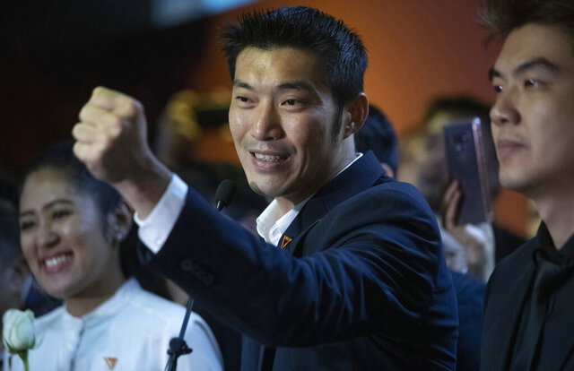 FILE - In this Jan. 21, 2020, file photo, Thailand's Future Forward Party leader Thanathorn Juangroongruangkit gestures as he talks to media during a press conference at the party's headquarters in Bangkok, Thailand. Thai officials on Wednesday, Jan. 20, 2021, filed criminal charges against Thanathorn, accusing him of defaming the monarchy by broadcasting his criticisms of the government's efforts to secure supplies of coronavirus vaccine. (AP Photo/Sakchai Lalit, File)
