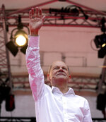 Olaf Scholz, German Finance Minister and top candidate for Chancellor, speaks at the final election campaign event of the Social Democratic Party, SPD, in Cologne, Germany, Friday, Sept. 24, 2021. The German elections will take place next Sunday, Sept. 26. (AP Photo/Martin Meissner, POOL)