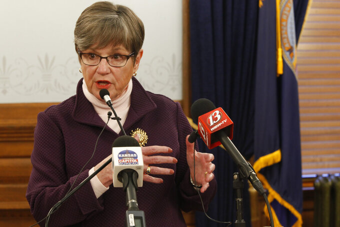Kansas Gov. Laura Kelly answers questions about the COVID-19 pandemic during a news conference, Wednesday, March 3, 2021, at the Statehouse in Topeka, Kan. The Republican-controlled Legislature is considering changes in the state's emergency laws and limits on the governor's power during pandemics and other emergencies. (AP Photo/John Hanna)