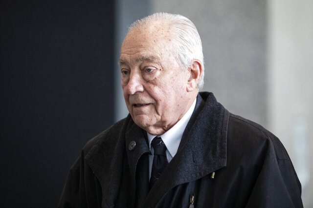 "FILE - In this Thursday, March 7, 2019 file photo, Former Chicago alderman Edward R. Vrdolyak walks with his lawyers out of the Dirksen Federal Courthouse in Chicago after pleading guilty to federal tax evasion charges. Vrdolyak, a former Chicago alderman nicknamed ""Fast Eddie"" for his backroom dealing is headed to prison for tax evasion. District Judge Robert Dow sentenced Vrdolyak on Friday, Dec. 4, 2020 adding he will hold a hearing in three months to discuss when Vrydolyak will report to prison.(Ashlee Rezin/Chicago Sun-Times via AP, File)"
