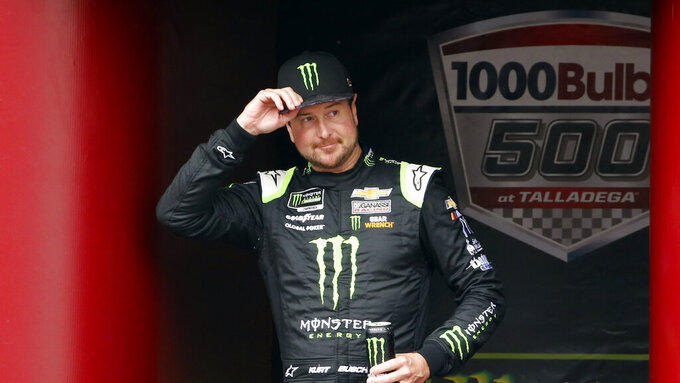 Monster Energy NASCAR Cup Series driver Kurt Busch (1) waves at driver introductions during a NASCAR Cup Series auto race at Talladega Superspeedway, Sunday, Oct. 14, 2019, in Talladega, Ala. (AP Photo/Butch Dill)