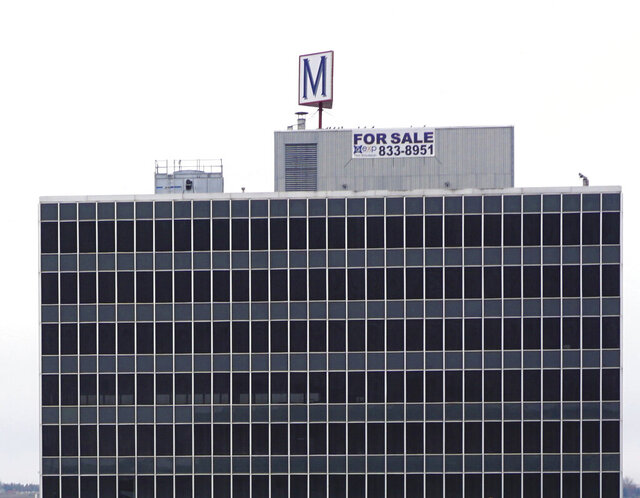 This Nov. 15, 2019 photo shows the former Midwest Federal bank building is known as the M Building in Minot, N.D.  The big M on its roof established the eight-story former Midwest Federal Savings Bank as a Minot landmark, and many memories were made by folks who entered the building's doors over the past 57 years. (Jill Schramm/Minot Daily News via AP)