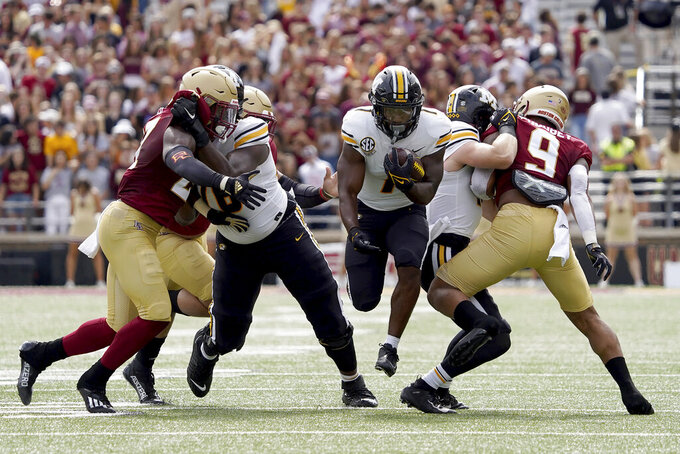 Missouri running back Tyler Badie (1) rushes through a hole during the first half of an NCAA college football game against Boston College, Saturday, Sept. 25, 2021, in Boston. (AP Photo/Mary Schwalm)