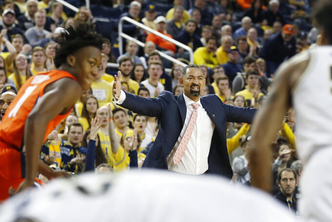Michigan head coach Juwan Howard disputes a call after a play during the first half of an NCAA college basketball game against Illinois, Saturday, Jan. 25, 2020, in Ann Arbor, Mich. (AP Photo/Carlos Osorio)