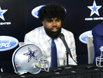 Dallas Cowboys running back Ezekiel Elliott speaks about his new contract during a news conference at the team's NFL football team's practice facility in Frisco, Texas, Thursday, Sept. 5, 2019. Elliott's agreement on a new contract ended a holdout that covered all of training camp and the preseason and came four days before the season opener at home against the New York Giants. (AP Photo/Tony Gutierrez)