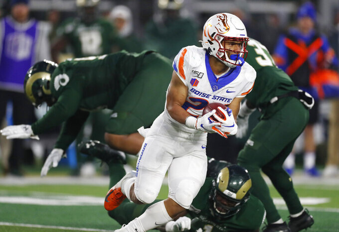 Boise State running back George Holani runs past Colorado State defenders after pulling in a pass in the second half of an NCAA college football game Friday, Nov. 29, 2019, in Fort Collins, Colo. Boise State won 31-24. (AP Photo/David Zalubowski)