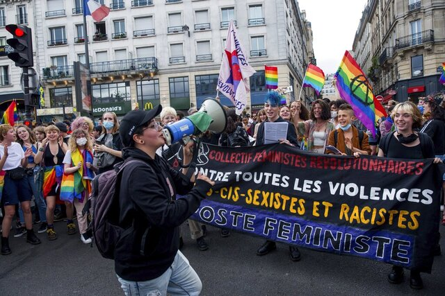 Young demonstrators dance at the start of the annual Gay Pride march in Paris, France, Saturday, July 4, 2020. (AP Photo/Benjamin Girette)