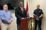 Saadiq Pettyjohn, center, son of Samuel Pettyjohn, speaks at a news conference, Wednesday, June 9, 2021, in Chattanooga, Tenn. Law enforcement officials announced the closing a 42-year-old cold case of Samuel Pettyjohn, a Chattanooga businessman who was shot and killed in 1979 in a contract killing that former Gov. Ray Blanton's administration helped pay for. (AP Photo/Kimberlee Kruesi)