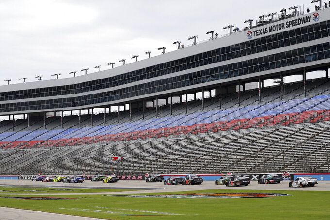 Cars pass in front of the grandstand during a NASCAR Xfinity Series auto race at Texas Motor Speedway in Fort Worth, Texas, Saturday Oct. 24, 2020. (AP Photo/Richard W. Rodriguez)