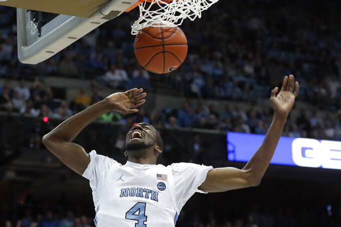 North Carolina guard Brandon Robinson (4) dunks against Boston College during the first half of an NCAA college basketball game in Chapel Hill, N.C., Saturday, Feb. 1, 2020. (AP Photo/Gerry Broome)