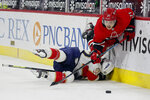 Carolina Hurricanes' Jesper Fast (71) collides with Florida Panthers' MacKenzie Weegar (52) during the second period of an NHL hockey game in Raleigh, N.C., Sunday, March 7, 2021. (AP Photo/Karl B DeBlaker)