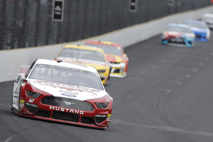 NASCAR Cup Series driver Ryan Blaney drives into turn one during the NASCAR Brickyard 400 auto race at the Indianapolis Motor Speedway, Sunday, Sept. 8, 2019, in Indianapolis. (AP Photo/Darron Cummings)